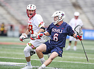 College Park, MD - May 13, 2018: Robert Morris Colonials Daniel Smith (6) holds off a Maryland Terrapins defender during the NCAA first round game between Robert Morris and Maryland at  Capital One Field at Maryland Stadium in College Park, MD.  (Photo by Elliott Brown/Media Images International)