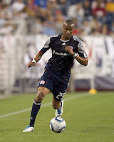 New England Revolution defender Darrius Barnes (25) dribbles down the wing. In a Major League Soccer (MLS) match, the Los Angeles Galaxy defeated the New England Revolution, 1-0, at Gillette Stadium on May 28, 2011.