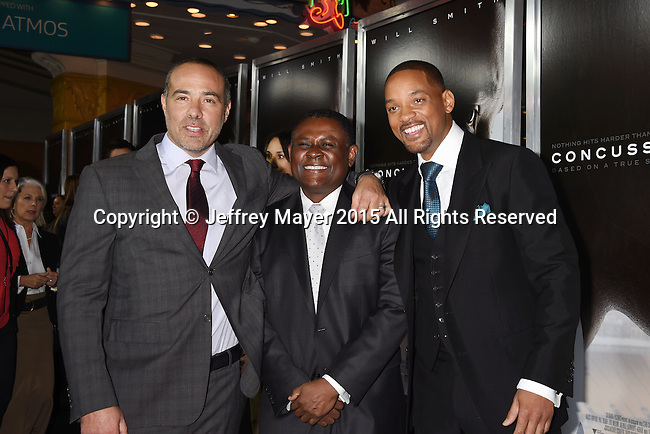 WESTWOOD, CA - NOVEMBER 23: (L-R) Director/writer Peter Landesman, Dr. Bennet Omalu and actor Will Smith attend the screening of Columbia Pictures' 'Concussion' at the Regency Village Theater on November 23, 2015 in Westwood, California.
