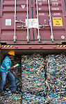 18 September 2019, Jakarta, Indonesia: A dock worker shows  containers of domestic waste that was sent to Indonesia for processing by Australia. It is being returned after inspection by Indonesian authorities who uncovered illegal waste hidden in among the genuine waste. After a huge outcry at the illegal waste being sent from Australia the Australian Government has stopped export of waste overseas to be processed domestically instead. Picture by Graham Crouch/The Australian