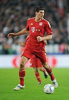 Fussball 1. Bundesliga:  Saison   2011/2012    16. Spieltag    11.12.2011 VfB Stuttgart 1-2 FC Bayern Muenchen   Mario Gomez (FC Bayern Muenchen) am Ball
