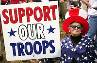 "VALLEY FORGE, PA - MARCH 16: Amelie Fretz, of Lansdale, Pennsylvania, holds a ""Support Our Troops"" sign during a ""Rally for America,"" March 16, 2003, in Valley Forge, Pennsylvania. Thousands of people attended the event to show their support for American troops readying for possible military conflict in Iraq. (Photo by William Thomas Cain/Getty Images)"
