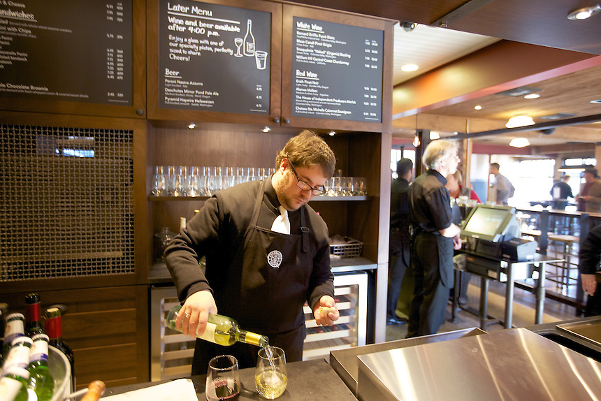 10/17/10 3:18:39 PM -- Seattle, WA, U.S.A - Barista Supervisor Casey O'Neill serves up wine that wine bar in the newly remodeled Starbucks in Seattle. Starbucks is now offering wine, beer and dinner fare at their stores..Photo by Stephen Brashear, Freelance.