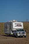 Dodge RAM truck and Montana fifth wheel trailer in Arizona desert.