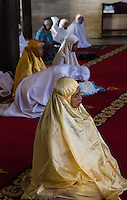 Yogyakarta, Java, Indonesia.  Women Awaiting Mid-day Prayers in the Great Mosque, Masjid Gedhe Kauman, mid-18th. Century.