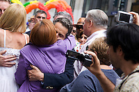 City Council Speaker Christine Quinn and Governor Andrew Cuomo hug before the 2011 NYC Pride March on 26 June 2011 in New York, New York, two days after the New York State Senate voted 33-29 to legalize gay marriage.