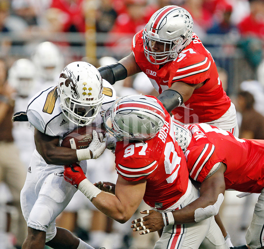 Ohio State Buckeyes defensive lineman Joey Bosa (97), Ohio State Buckeyes linebacker Raekwon McMillan (5) and Ohio State Buckeyes linebacker Joshua Perry (37) tackle Western Michigan Broncos running back Jamauri Bogan (32) in the 4th quarter of their game at Ohio Stadium on September 26, 2015.  (Dispatch photo by Kyle Robertson)