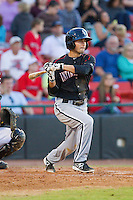 Michael Johnson (5) of the Kannapolis Intimidators follows through on his swing against the Hickory Crawdads at L.P. Frans Stadium on May 25, 2013 in Hickory, North Carolina.  The Crawdads defeated the Intimidators 14-3.  (Brian Westerholt/Four Seam Images)