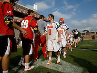 Adam Ghitelman (8) of Virginia congratulates Zach Williams (49) of Maryland on playing a good game after the ACC men's lacrosse tournament finals in College Park, MD.  Virginia defeated Maryland, 10-6.