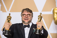 Guillermo del Toro pose backstage with the Oscar&reg; for best motion picture  and best director for work on &ldquo;The Shape of Water&rdquo; during the live ABC Telecast of The 90th Oscars&reg; at the Dolby&reg; Theatre in Hollywood, CA on Sunday, March 4, 2018.<br /> *Editorial Use Only*<br /> CAP/PLF/AMPAS<br /> Supplied by Capital Pictures