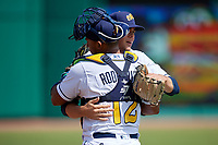Montgomery Biscuits starting pitcher Dalton Moats (11) and catcher David Rodriguez (12) hug before a Southern League game against the Mobile BayBears on May 2, 2019 at Riverwalk Stadium in Montgomery, Alabama.  Mobile defeated Montgomery 3-1.  (Mike Janes/Four Seam Images)