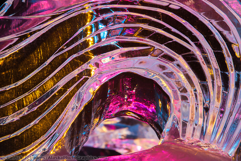 Colored lights accentuate the detail of ice sculptures.