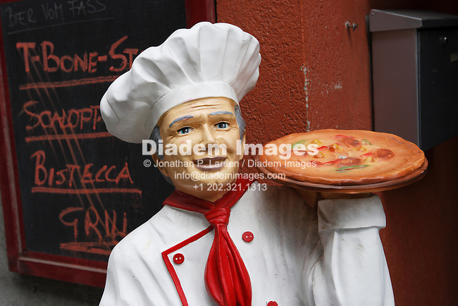 A pizza man mannequin advertising outside a restaurant in Vienna, Austria.
