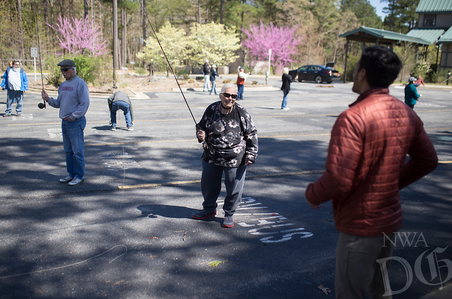 NWA Democrat-Gazette/CHARLIE KAIJO  Instructor Sallyann Brown (center) assists a student during a fly fishing class, Sunday, April 14, 2019 at Hobbs State Park in Rogers.<br /> <br /> Instructor Sallyann Brown, past recipient of the &ldquo;Woman of the Year&rdquo; and the &ldquo;Federation of Fly Fishers Educator of the Year&rdquo; awards from the Federation of Fly Fishers, Inc. taught a four hour fly fishing class.<br /> <br /> Participants learned four basic casts, the six basic types of flies (lures), how to cast and &ldquo;play&rdquo; the flies in the water, how to read water, how to wade, how to purchase and assemble equipment, how to store equipment and how to tie the four basic knots used by fly fishers.