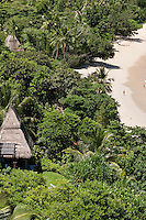 The individual guest villas that make up the Maia Luxury Resort & Spa can be seen amidst the lush vegetation that lines the beach