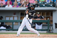 Micah Johnson (3) of the Charlotte Knights makes contact with the baseball against the Columbus Clippers at BB&T BallPark on May 27, 2015 in Charlotte, North Carolina.  The Clippers defeated the Knights 9-3.  (Brian Westerholt/Four Seam Images)