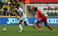 Tammy Abraham of Swansea City against Abdoulaye Doucoure of Watford during the Premier League match between Swansea City and Watford at The Liberty Stadium, Swansea, Wales, UK. Saturday 23 September 2017