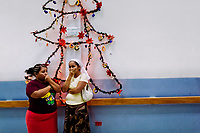 Salvadoran women cry in the hospital corridor as they brought a deadly injured family member to the emergency department of a public hospital in San Salvador, El Salvador, 16 December 2015.