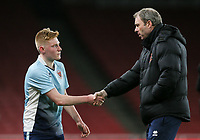 Blackpool U18's Professional Development Phase Coach John Murphy shakes hands with Blackpool U18's Owen Watkinson on his substitution<br /> <br /> Photographer Andrew Kearns/CameraSport<br /> <br /> Emirates FA Youth Cup Semi- Final Second Leg - Arsenal U18 v Blackpool U18 - Monday 16th April 2018 - Emirates Stadium - London<br />  <br /> World Copyright &copy; 2018 CameraSport. All rights reserved. 43 Linden Ave. Countesthorpe. Leicester. England. LE8 5PG - Tel: +44 (0) 116 277 4147 - admin@camerasport.com - www.camerasport.com