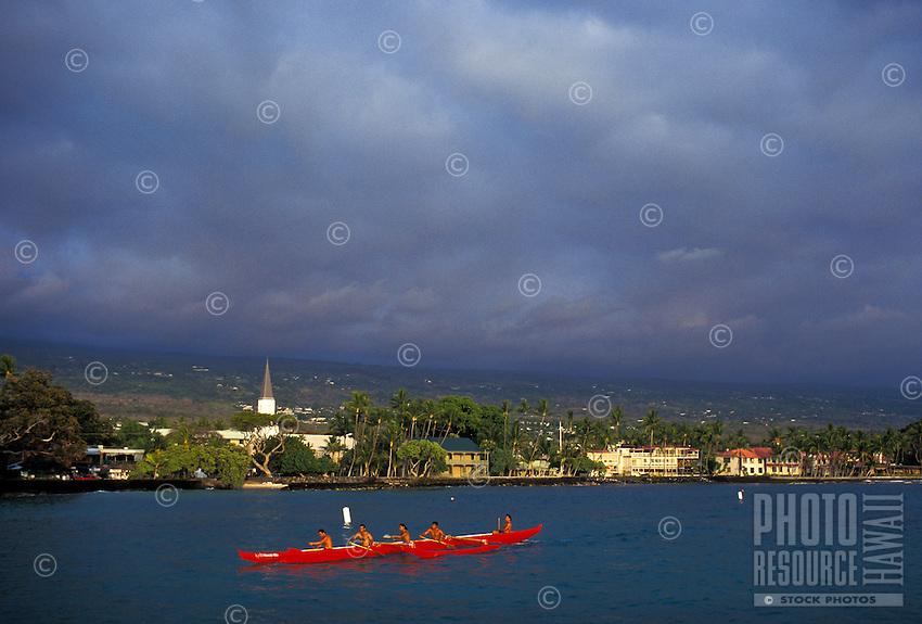Outrigger canoe glows at the golden hour off the coast of Kailua Kona