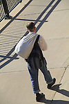 Homeless man walks with his belongings in Denver, Colorado. .  John offers private photo tours in Denver, Boulder and throughout Colorado. Year-round Colorado photo tours.