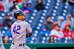 15 April 2018: Colorado Rockies first baseman Ian Desmond watches the trajectory of his game winning solo home run in the 9th inning against the Washington Nationals at Nationals Park in Washington, DC. All MLB players wore Number 42 to commemorate the life of Jackie Robinson and to celebrate Black Heritage Day in pro baseball. The Rockies edged out the Nationals 6-5 to take the final game of their 4-game series. Mandatory Credit: Ed Wolfstein Photo *** RAW (NEF) Image File Available ***