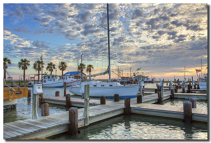 Rockport Harbor awakens in the morning along the Texas Coast. Birds wait for shrimp boats to return and visitors and locals prepare for another beautiful October morning.