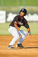 Cleuluis Rondon (13) of the Kannapolis Intimidators puts on the brakes after rounding second base against the Rome Braves at CMC-Northeast Stadium on August 25, 2013 in Kannapolis, North Carolina.  The Intimidators defeated the Braves 9-0.  (Brian Westerholt/Four Seam Images)