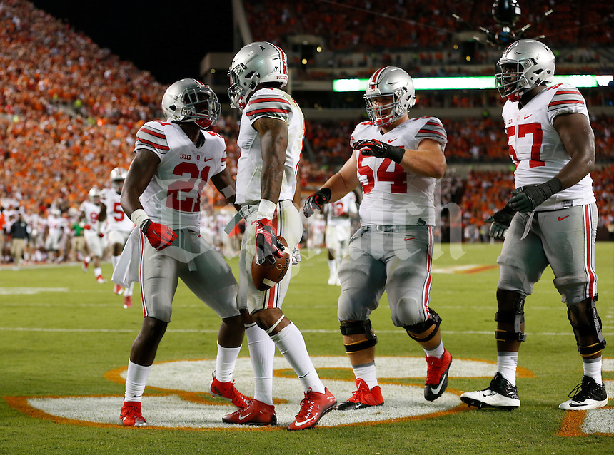 Ohio State Buckeyes wide receiver Braxton Miller (1) is congratulated after a touchdown by Ohio State Buckeyes wide receiver Parris Campbell (21) and offensive linemen Billy Price (54) and Chase Farris (57) during Monday's NCAA Division I football game  against the Virginia Tech Hokies in Blacksburg, Va., on September 7, 2015. Ohio State won the game 42-24. (Dispatch Photo by Barbara J. Perenic)