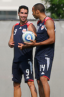 New York Red Bulls Juan Pablo Angel (9) talks with new teammate Thierry Henry (14) during a New York Red Bulls practice on the campus of Montclair State University in Upper Montclair, NJ, on July 16, 2010.