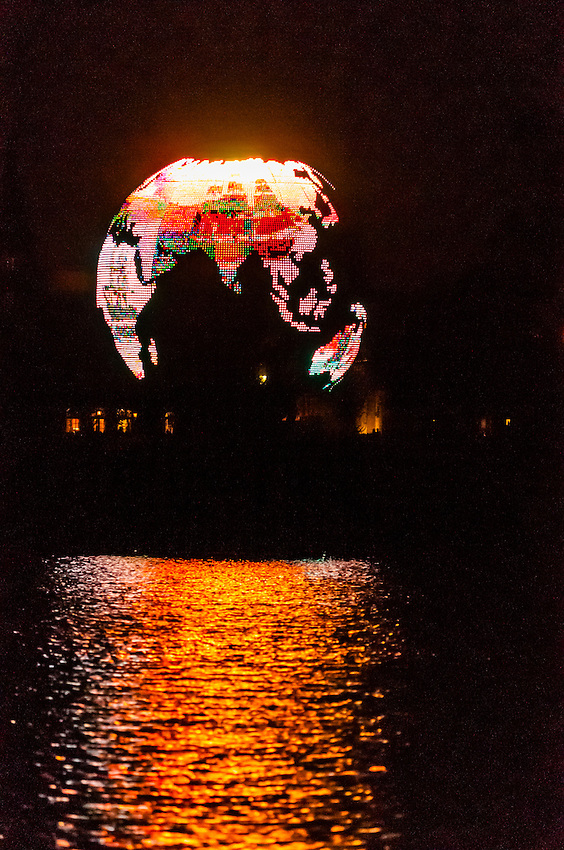 Spaceship Earth (geosphere) during the IllumiNations:Reflections of Earth fireworks and laser show,World Showcase Lagoon,  Epcot, Walt Disney World, Orlando, Florida USA