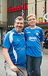 Rosenborg v St Johnstone....17.07.13  UEFA Europa League Qualifier.<br /> St Johnstone fans in Trondheim..Pictured from left Andrew Climie and son Callum (7)<br /> Picture by Graeme Hart.<br /> Copyright Perthshire Picture Agency<br /> Tel: 01738 623350  Mobile: 07990 594431