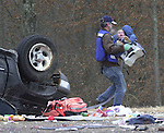 Emergency Medical Responder Dwight Frank carries Christian Finn to a waiting ambulance following a wreck that killed his mother and sister on Thursday, December 23, 2004 in Oxford, Miss.