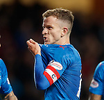 Andy Halliday shows what it means by kissing the Rangers badge after scoring