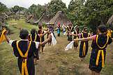 INDONESIA, Flores, Ngadha District, residents of Belaraghi village dance and sing to welcome new guests into their village