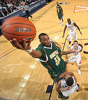Dec. 20, 2010; Charlottesville, VA, USA; Norfolk State Spartans guard/forward Rodney McCauley (15) goes over Virginia Cavaliers guard Mustapha Farrakhan (2) to the basket during the game at the John Paul Jones Arena. Virginia won 50-49. Mandatory Credit: Andrew Shurtleff