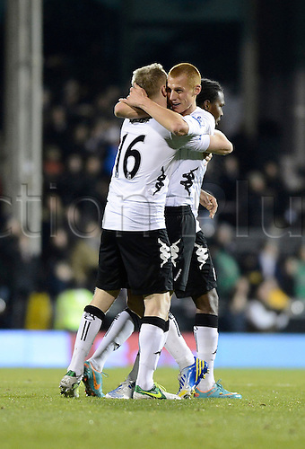10.12.2012 London, England. Steve Sidwell of Fulham  celebrates scoring the games first goal with Damien Duff during the Premier League game between Fulham and Newcastle United from Craven Cottage.
