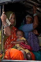 Women and child in the back of the local jeep near Varanasi India