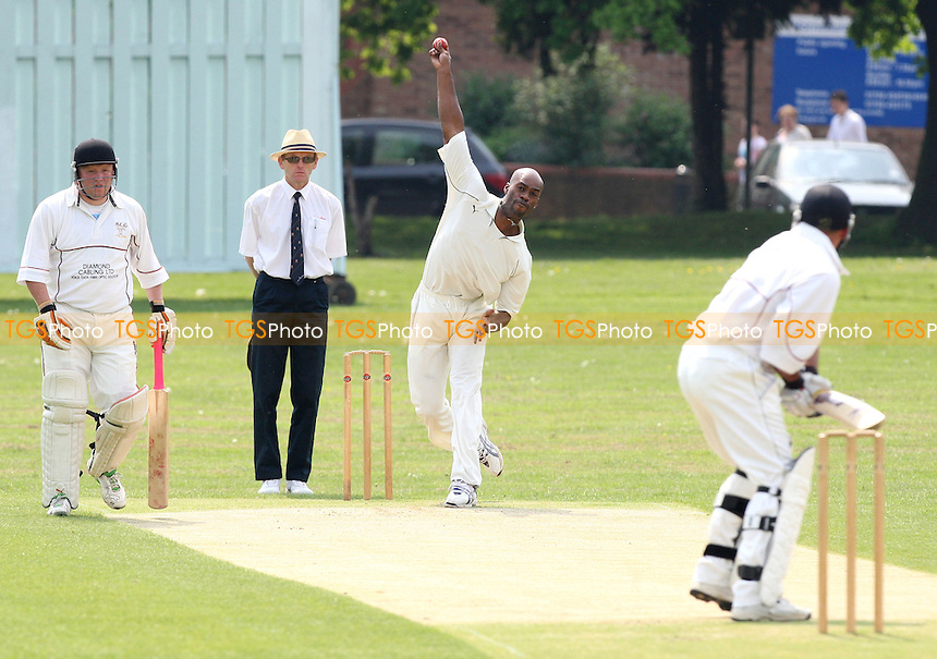 Ex-England cricketer Chris Lewis bowls his first ball on debut for Ilford CC to Hornchurch batsman D Robinson - Hornchurch CC vs Ilford CC - Shepherd Neame Essex Cricket League Division One at Harrow Lodge Park, Hornchurch Road, Hornchurch, Essex - 10/05/08 - MANDATORY CREDIT: Gavin Ellis/TGSPHOTO. Self-Billing applies where appropriate. NO UNPAID USE. Tel: 0845 094 6026