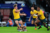 Michael Hooper of Australia offloads the ball. The Rugby Championship match between Argentina and Australia on October 8, 2016 at Twickenham Stadium in London, England. Photo by: Patrick Khachfe / Onside Images