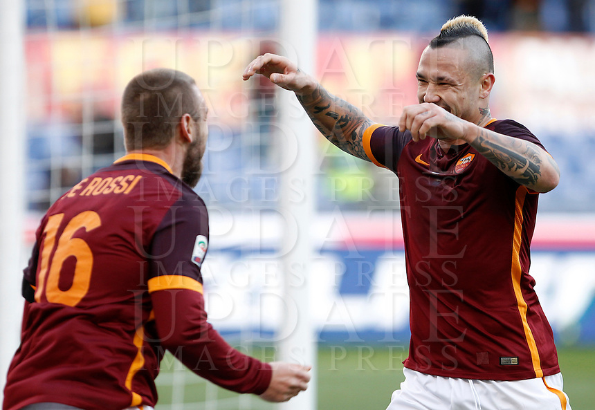 Calcio, Serie A: Roma vs Hellas Verona. Roma, stadio Olimpico, 17 gennaio 2016.<br /> Roma&rsquo;s Radja Nainggolan, right, celebrates with teammate Daniele De Rossi after scoring during the Italian Serie A football match between Roma and Hellas Verona at Rome's Olympic stadium, 17 January 2016.<br /> UPDATE IMAGES PRESS/Isabella Bonotto