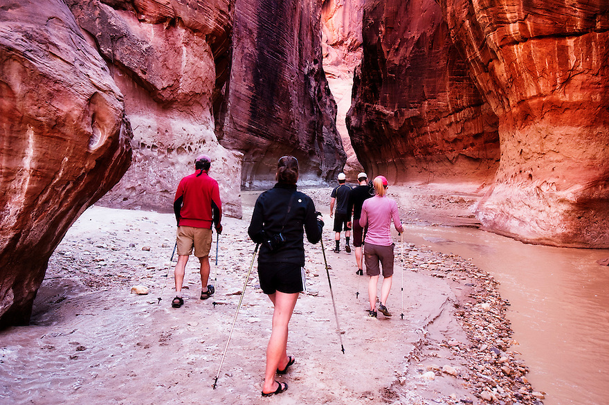 Hikers explore the Paria River near the confluence with Buckskin Gulch.