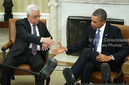 United States President Barack Obama (R) shakes hands with Palestinian President Mahmoud Abbas (L) during a meeting in the Oval Office of the White House March 17, 2014 in Washington, DC. President Obama met with President Abbas to discuss the progress in the Israeli-Palestinian negotiations and the establishment of a Palestinian state.  <br /> Credit: Alex Wong / Pool via CNP