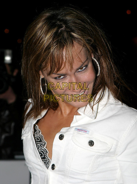 TARA PALMER TOMKINSON.Daily Mirror's Pride Of Britain Awards at the London Hilton, Park Lane.15 March 2004.headshot, portrait, funny face, hoop earrings, sass & bide top.www.capitalpictures.com.sales@capitalpictures.com.© Capital Pictures.