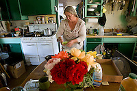 Maryann Pratt makes lunch in her ranch house.  (Pat Shannahan/ The Arizona Republic)