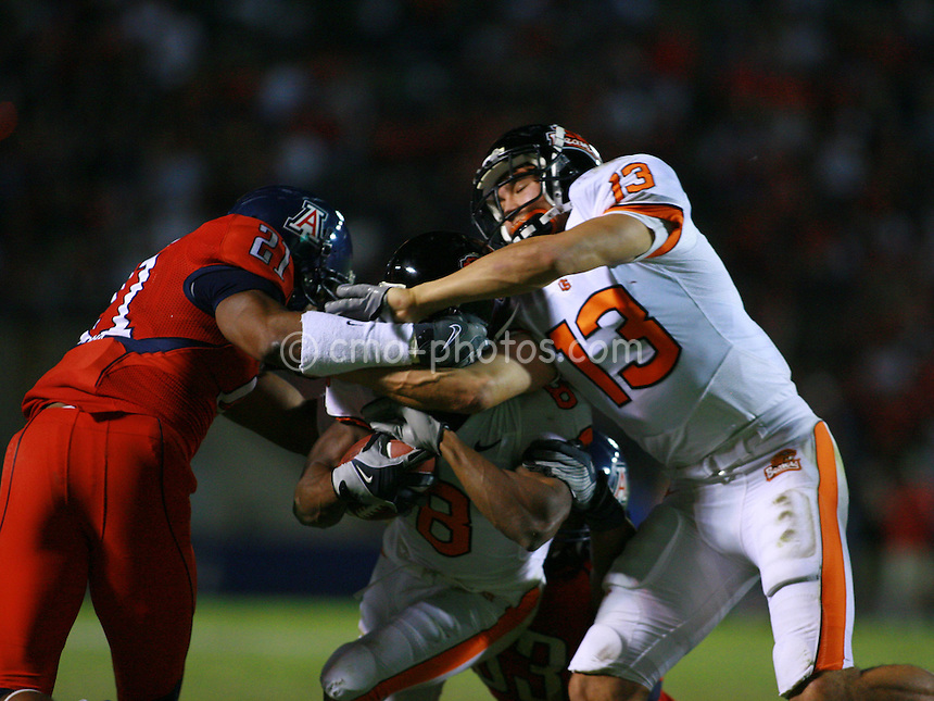 Nov 22, 2008; Tucson, AZ, USA; Oregon State wide receiver Shane Morales (13) tries to keep Arizona Wildcats safety Corey Hall (21) from tackling wide receiver James Rodgers (8) in the third quarter of a game at Arizona Stadium.  Oregon State won the game 19-17.