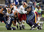 Washington Redskins guard Maurice Hunt blocks Seattle Seahawks defensive end Chris Clemons at  CenturyLink Field in Seattle, Washington on November 27, 2011. ©2011 Jim Bryant Photo. All Rights Reserved.
