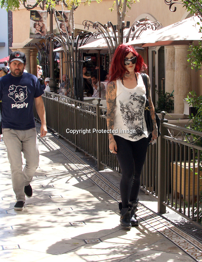 .August 24th 2010  ..Kat Von D leaving The Grove shopping center & The Cheesecake Factory after eating lunch with friends. Kat smiled & waved to the photographer. Kat looked great with her red hair big sunglasses black steel toe boots showing off all her tattoo's. ...AbilityFilms@yahoo.com.805-427-3519.www.AbilityFilms.com