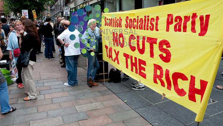Supported by the Scottish Socialist Party, branches of the NUJ, Unison, PCS and FBU held a rally in protest of Cuts that have arisen as part of the Lib-Con budget this week. The protesters held the rally on Glasgow's busy shopping district, Buchanan Street. ..Buchanan Street, Glasgow , Scotland.  Picture: Euan Anderson/Universal News And Sport (Scotland) 26th June 2010.