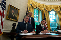 United States President Donald J. Trump was joined by Acting United States Secretary of Homeland Security Kevin McAleenan and Guatemalan Minister Enrique Degenhart for the signing of the Safe-Third Agreement in the Oval Office of the White House in Washington D.C., U.S. on July 26, 2019. Photo Credit: Stefani Reynolds/CNP/AdMedia